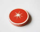 Atomic-starburst-paper-drink-coasters-in